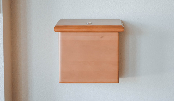 tithing box attached on a wall